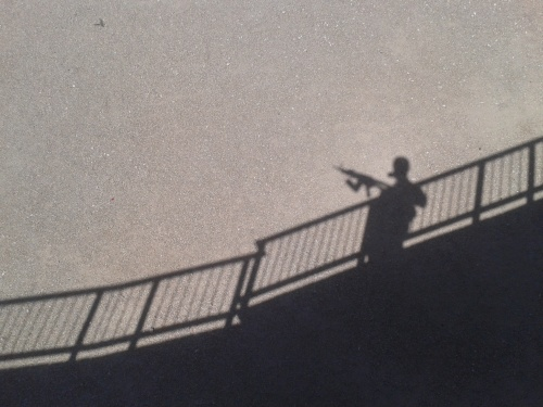My shadow over the railing