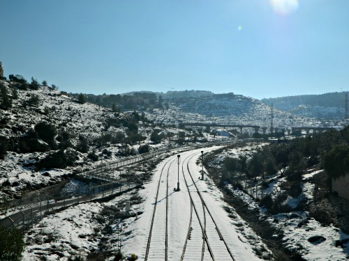 Snow-covered train tracks in Jerusalem