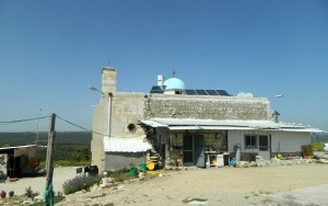 Iqrit church with house