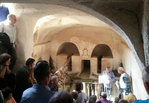 Lecture within the olive press cave