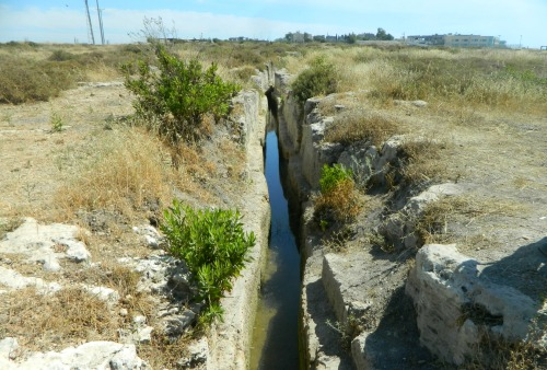 Manmade water channel carved out of the bedrock