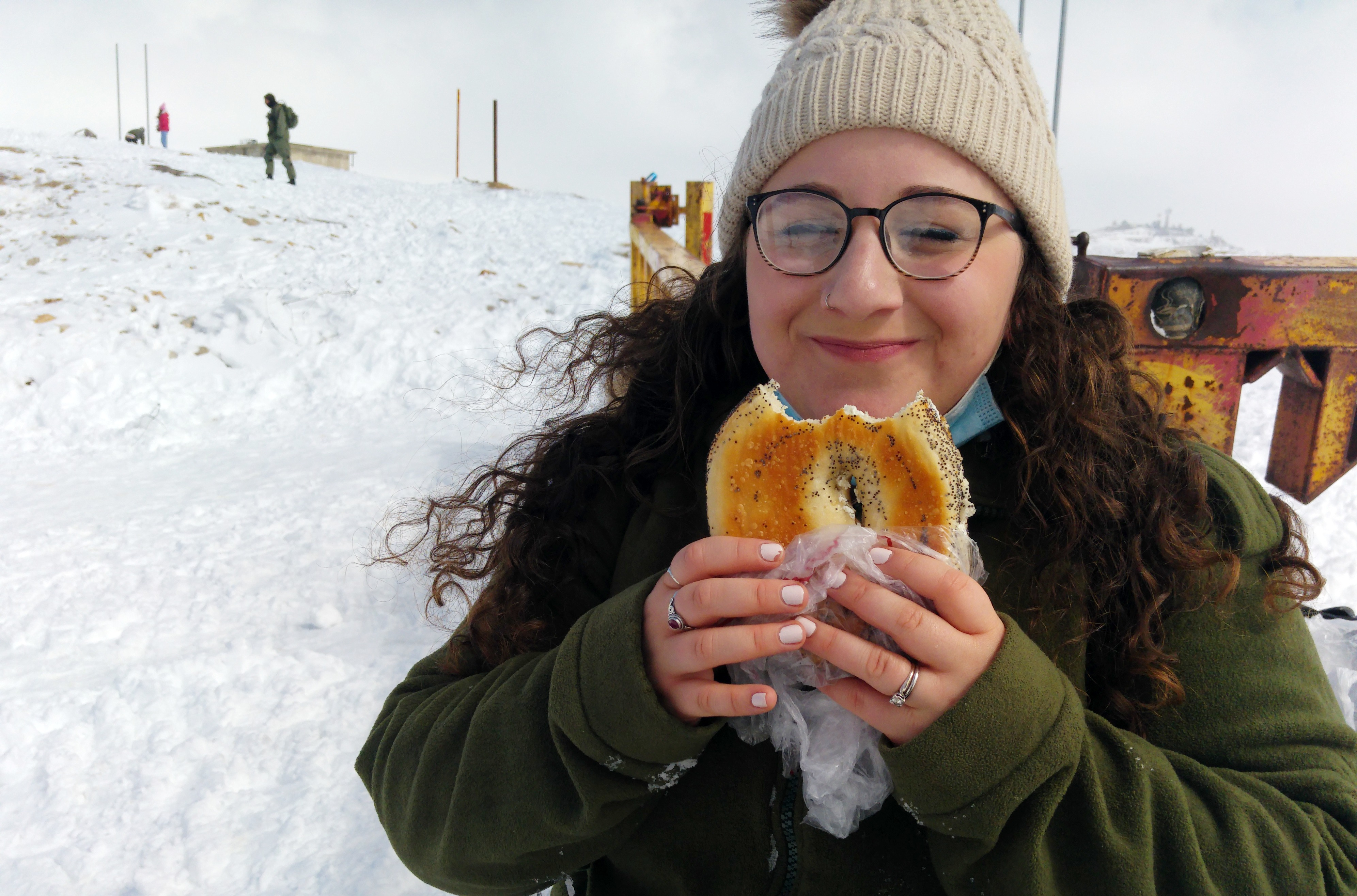 Bracha enjoying her bagel at the checkpoint